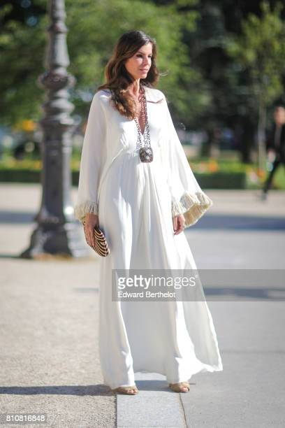 Christina Pitanguy wears a white lace dress outside the Giambattista Valli show during Paris Fashion Week Haute Couture Fall/Winter 20172018 on July...