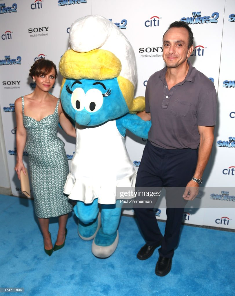 <a gi-track='captionPersonalityLinkClicked' href=/galleries/search?phrase=Christina+Ricci&family=editorial&specificpeople=239510 ng-click='$event.stopPropagation()'>Christina Ricci</a>, Smurfette and <a gi-track='captionPersonalityLinkClicked' href=/galleries/search?phrase=Hank+Azaria&family=editorial&specificpeople=204150 ng-click='$event.stopPropagation()'>Hank Azaria</a> attend 'The Smurfs 2' New York Blue Carpet Screening at Lighthouse International Theater on July 28, 2013 in New York City.
