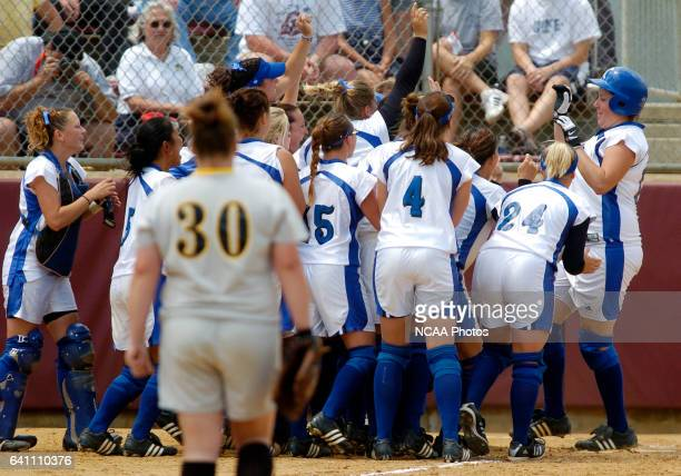 Christina Rolla of Lynn University is congratulated at home plate after hitting a homerun against Kennesaw State University during the Division II...