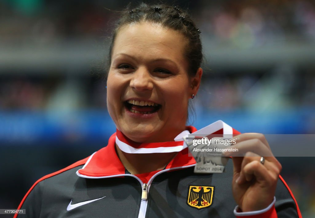 <a gi-track='captionPersonalityLinkClicked' href=/galleries/search?phrase=Christina+Schwanitz&family=editorial&specificpeople=2287569 ng-click='$event.stopPropagation()'>Christina Schwanitz</a> of Germany celebrates winning the silver medal in the Women's Shot Put final during the medal ceremony on day two of the IAAF World Indoor Championships at Ergo Arena on March 8, 2014 in Sopot, Poland.