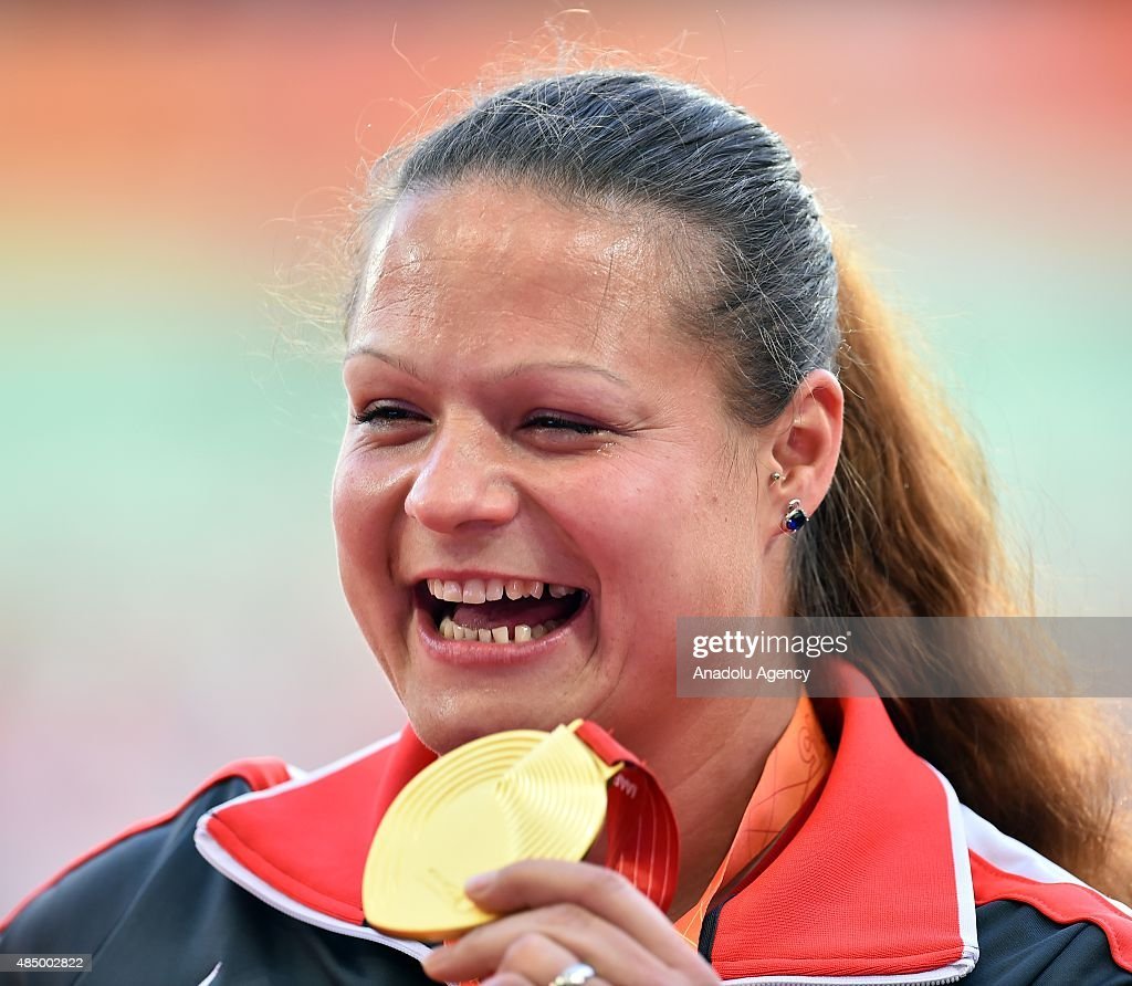 <a gi-track='captionPersonalityLinkClicked' href=/galleries/search?phrase=Christina+Schwanitz&family=editorial&specificpeople=2287569 ng-click='$event.stopPropagation()'>Christina Schwanitz</a> of Germany poses with her gold medal on the podium after winning the women's Shot Put final during the '15t IAAF World Athletics Championships Beijing 2015' at Beijing National Stadium (Bird's Nest) on August 23, 2015.