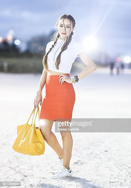 Christina Walsh is seen outside of the Scope Art Show wearing a BCBG skirt Misguided top Goyard bag and Stan Smith sneakers during Art Week Miami...