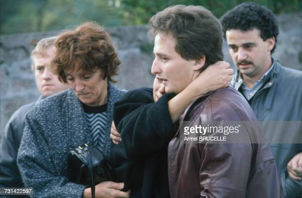Christine and JeanMarie Villemin parents of murdered four yearold boy Grégory Villemin at his funeral in Lepanges Sur Vologne Vosges France 19th...