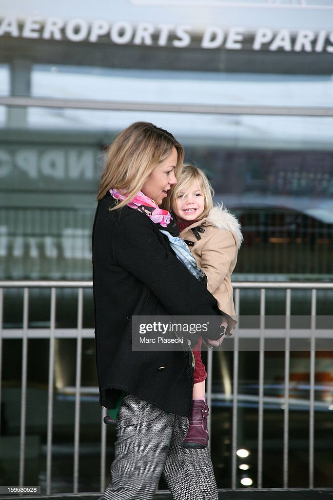 Christine Baumgartner and her daughter Grace Avery are seen at Roissy airport on January 15, 2013 in Paris, France.