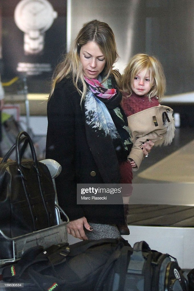 <a gi-track='captionPersonalityLinkClicked' href=/galleries/search?phrase=Christine+Baumgartner&family=editorial&specificpeople=212876 ng-click='$event.stopPropagation()'>Christine Baumgartner</a> and her daughter Grace Avery are seen at Roissy airport on January 15, 2013 in Paris, France.