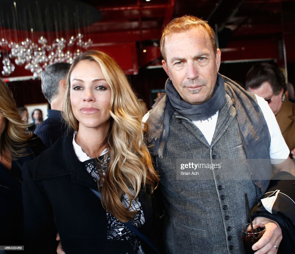 Christine Baumgartner and Kevin Costner attend the 2014 Leigh Steinberg Super Bowl Party at 230 Fifth Avenue on February 1 2014 in New York City