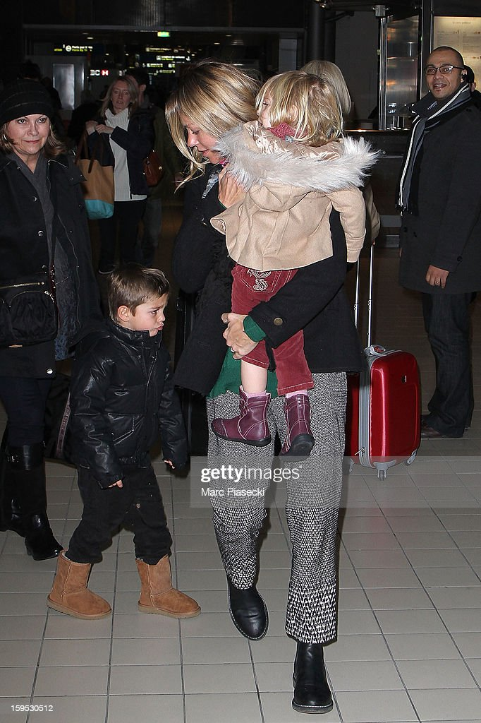 Christine Baumgartner, her son Hayes and her daughter Grace Avery are seen at Roissy airport on January 15, 2013 in Paris, France.