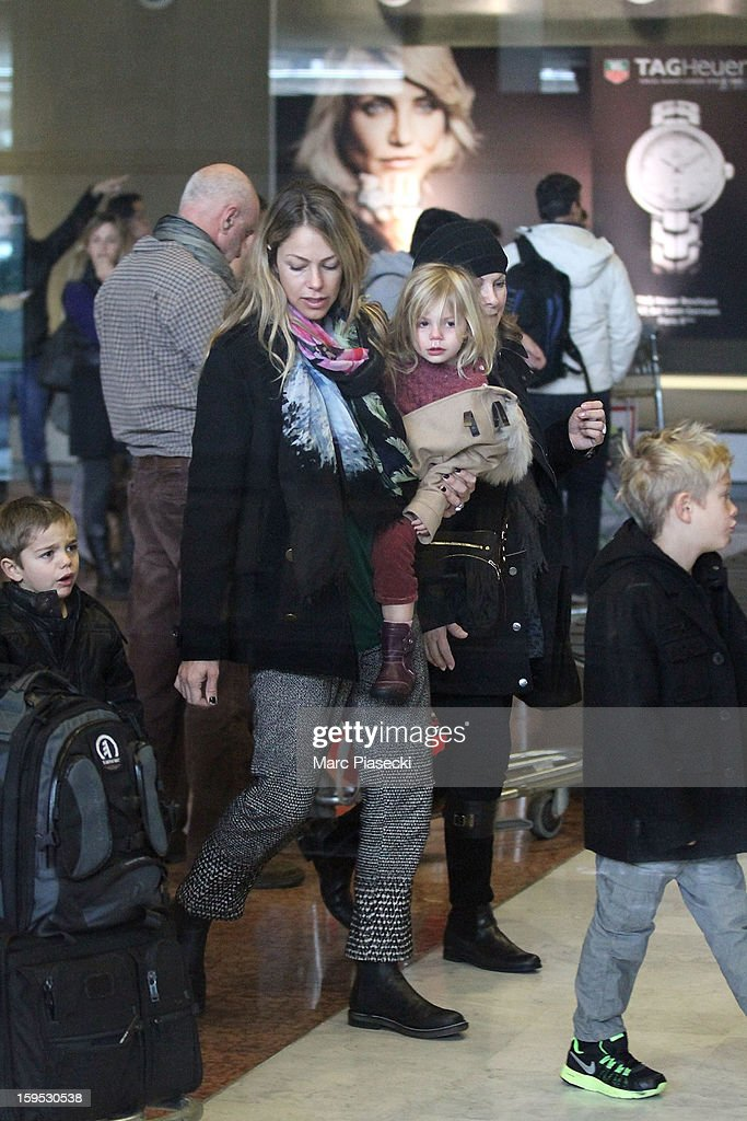 Christine Baumgartner, her sons Hayes and Cayden and her daughter Grace Avery are seen at Roissy airport on January 15, 2013 in Paris, France.