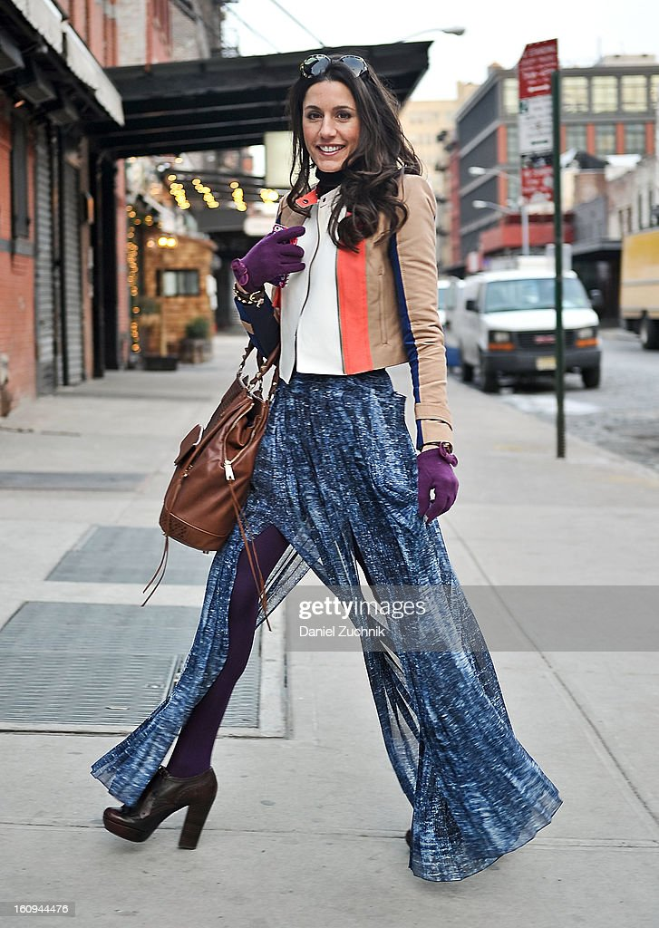 Christine Bibbo Herr, fashion blogger from New York, seen outside the Houghton show wearing a BCBG jacket and skirt with Frye boots, Rebecca Minkoff bag and a Lulu Frost necklace on February 7, 2013 in New York City.
