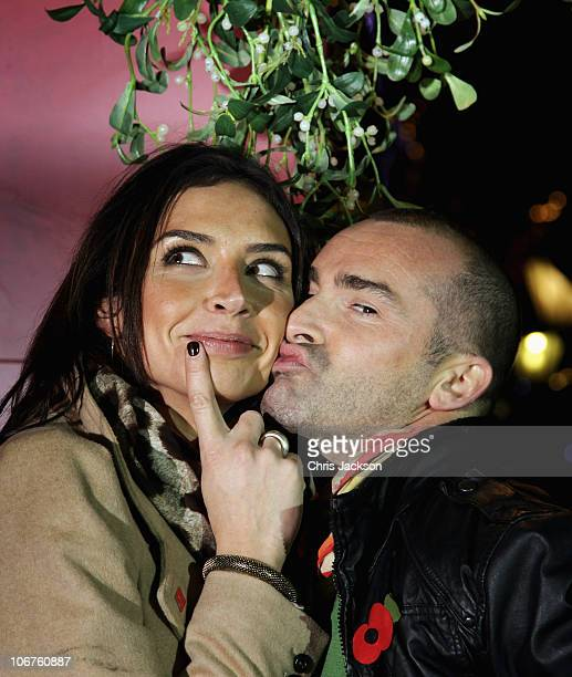 Christine Bleakley and Louis Spence pose during the Covent Garden Market Merry Kissmas Launch on November 11 2010 in London England