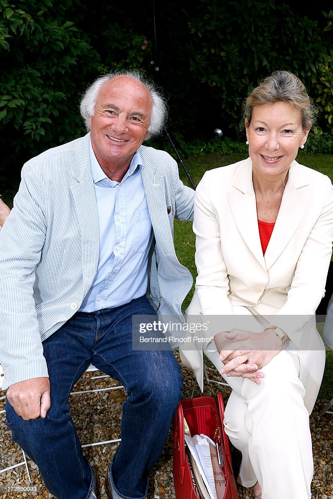 Christine Borgoltz (R) and her husband Serge Halff attend the Frank Sorbier show as part of Paris Fashion Week Haute-Couture Fall/Winter 2013-2014 at Hotel De Bezenval on July 3, 2013 in Paris, France.