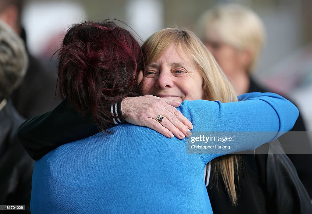 Christine Burke, the daughter of victim Henry Burke, embraces <a gi-track='captionPersonalityLinkClicked' href=/galleries/search?phrase=Margaret+Aspinall&family=editorial&specificpeople=6899634 ng-click='$event.stopPropagation()'>Margaret Aspinall</a> (R), the chairman of Hillsborough Family Support Group, as they arrive on the opening day for the fresh coroners inquest into the deaths of 96 Liverpool football fans who died in the 1989 Hillsborough tragedy, during which Lord Justice Goldring will be acting as coroner at the specially adapted office building in Birchwood Park on March 31, 2014 in Warrington, England. The new inquest hearing was ordered two years ago when the High Court quashed the original accidental death verdicts that had stood for more than 20 years. The Hillsborough disaster occurred during the FA Cup semi-final tie between Liverpool and Nottingham Forest football clubs in April 1989 at the Hillsborough Stadium in Sheffield, which resulted in the deaths of 96 football fans.