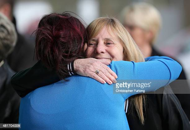Christine Burke the daughter of victim Henry Burke embraces Margaret Aspinall the chairman of Hillsborough Family Support Group as they arrive on the...