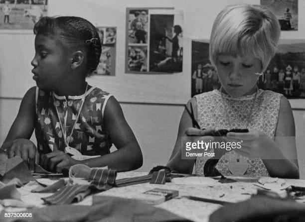 Christine Burks left and Angela Ramsey make dolls during church school Christine goes to Fruitdale ond Angela goes to Barrett Elementary Schools...