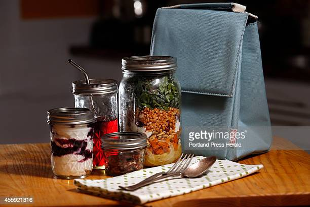 Christine Burns Rudalevige makes a sustainable lunch of apple grain salad yogurt and other snacks all packed in mason jars along with a cloth napkin...