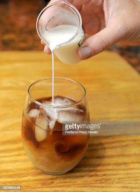 Christine Burns Rudalevige pours milk into the iced coffee after she made iced coffee without heating it first