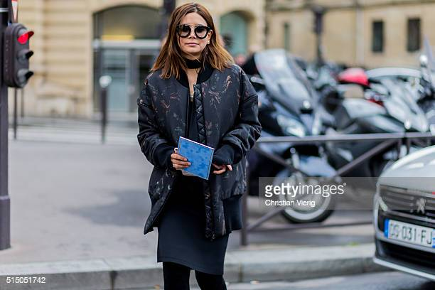 Christine Centenera wearing a black bomber jacket outside Miu Miu during the Paris Fashion Week Womenswear Fall/Winter 2016/2017 on March 9 2016 in...