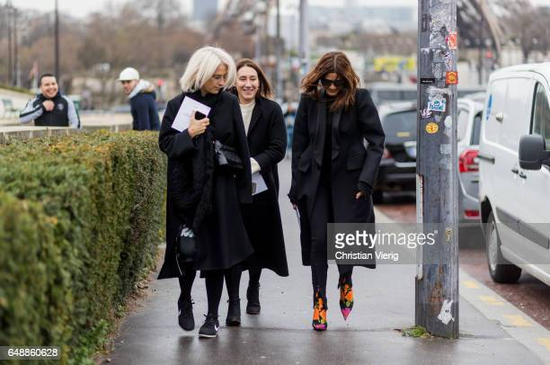 Christine Centenera wearing a black coat multi coloured ankle boots outside Hermes on March 6 2017 in Paris France