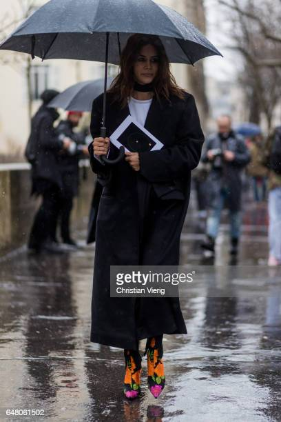 Christine Centenera wearing a black coat outside Mugler on March 4 2017 in Paris France