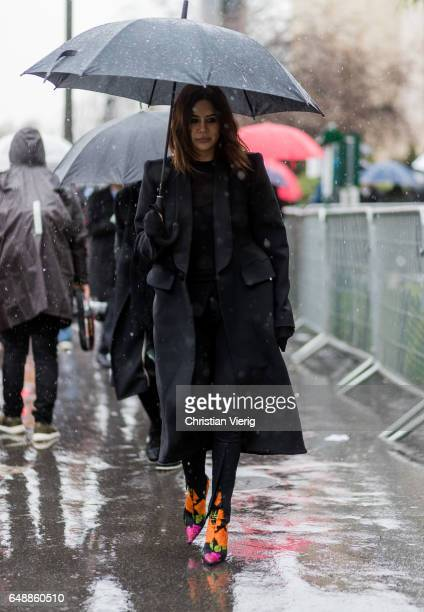 Christine Centenera wearing a black wool coat multi colour ankle boots outside Sacai on March 6 2017 in Paris France