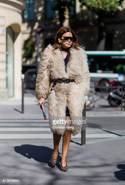 Christine Centenera wearing a fur coat outside Miu Miu on October 5 2016 in Paris France