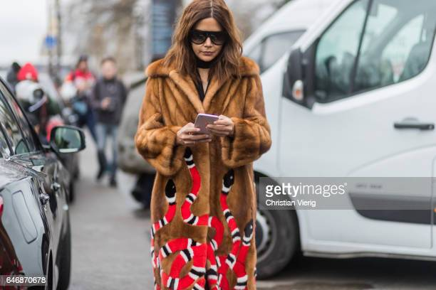 Christine Centenera wearing brown Gucci fur coat outside Maison Margiela on March 1 2017 in Paris France