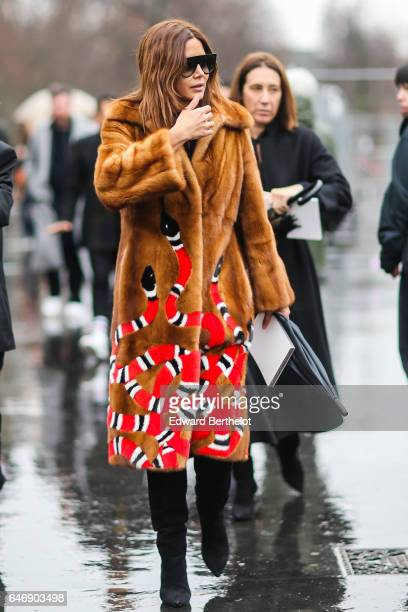 Christine Centenera wears fur coat outside the Dries Van Noten show during Paris Fashion Week Womenswear Fall/Winter 2017/2018 on March 1 2017 in...