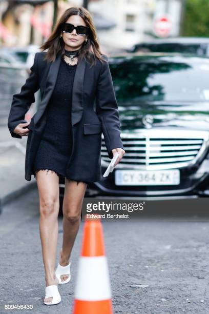 Christine Centenera wears sunglasses a black blazer jacket a black skirt white shoes outside the Fendi show during Paris Fashion Week Haute Couture...