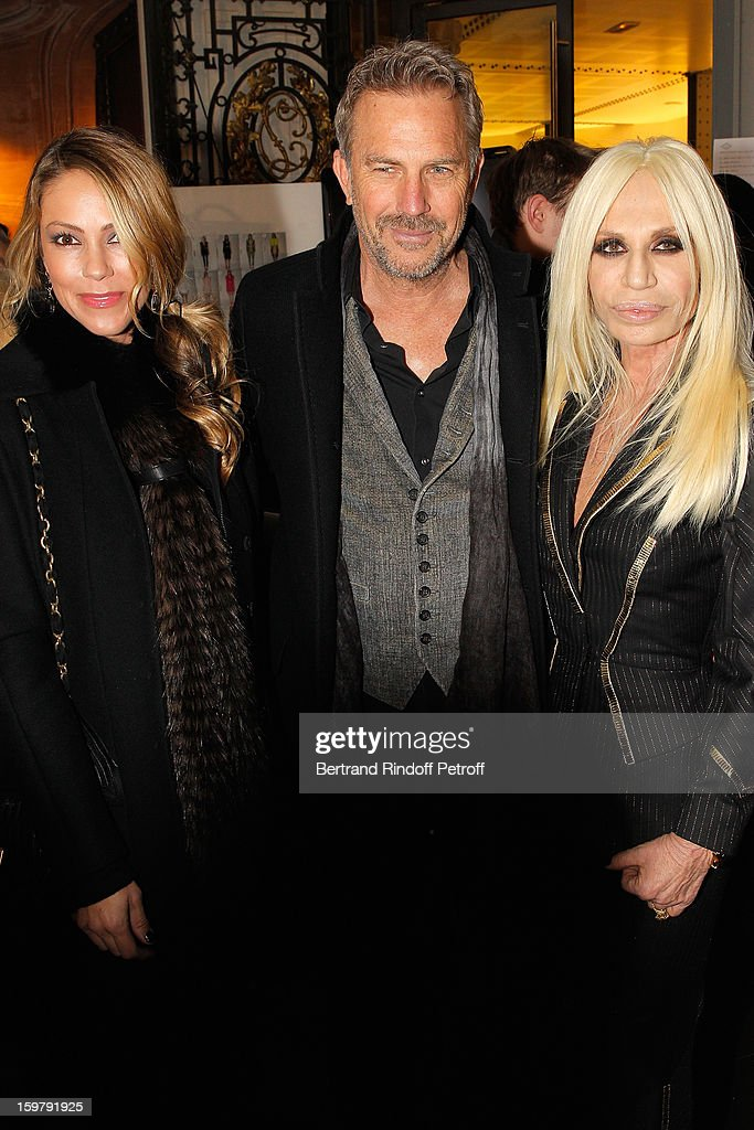 Christine Costner, her husband <a gi-track='captionPersonalityLinkClicked' href=/galleries/search?phrase=Kevin+Costner&family=editorial&specificpeople=201719 ng-click='$event.stopPropagation()'>Kevin Costner</a> and Donatella Versace attend the Versace Spring/Summer 2013 Haute-Couture show as part of Paris Fashion Week at Le Centorial on January 20, 2013 in Paris, France.