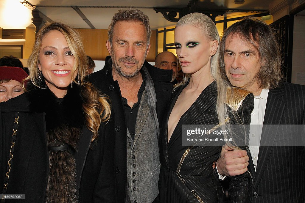 Christine Costner, her husband Kevin Costner, Kristen McMenamy and Ivor Braka attend the Versace Spring/Summer 2013 Haute-Couture show as part of Paris Fashion Week at Le Centorial on January 20, 2013 in Paris, France.
