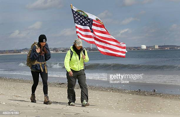 Christine Dion of Norton left and Heather Viveiros of Newton walk along Revere Beach on Thursday March 20 to train for the March 29 'Carry the...