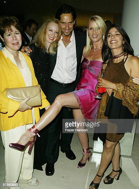 Christine Estabrook Marcia Horwitz guest Nicollette Sherdian and Pamela Lopez mingle at the Desperate Housewives premiere party at Barney's New York...