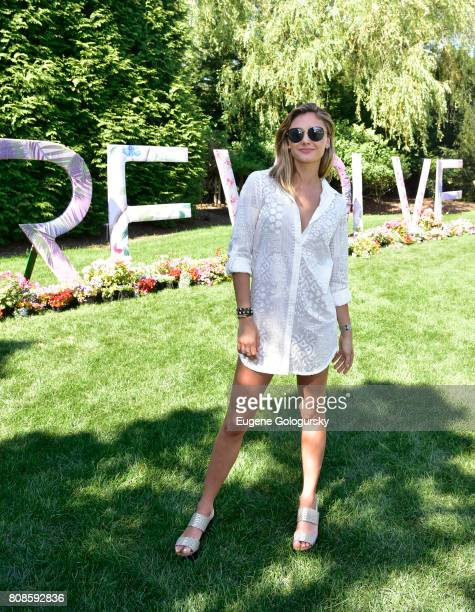 Christine Evangelista attends the FIJI Water At #REVOLVEintheHamptons 2017 on July 4 2017 in Bridgehampton New York