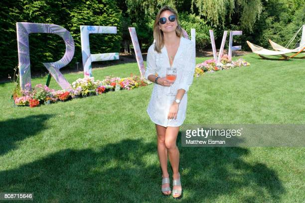Christine Evangelista toasts to #REVOLVEintheHamptons with Moet Chandon on July 4 2017 in Bridgehampton New York