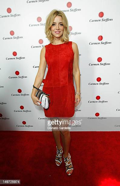 Christine Fernandes attends the grand opening of luxury Brazilian brand Carmen Steffens' US Flagship store on August 2 2012 in Hollywood California