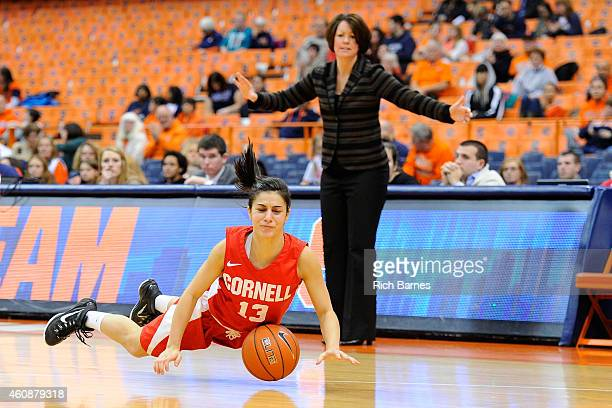 Christine Kline falls on the court as head coach Dayna Smith of the Cornell Big Red reacts on the sidelines during the second half at the Carrier...
