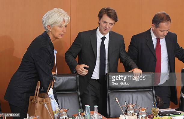 Christine Lagarde Director of the International Monetary Fund and and French Finance Minister Francois Baroin sit down for talks among world finance...