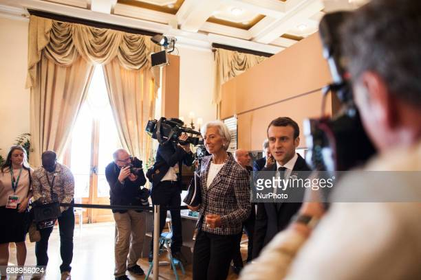 Christine Lagarde head of the International Monetary Fund and French President Emmanuel Macron at the G7 Summit expanded session in Taormina Sicily...