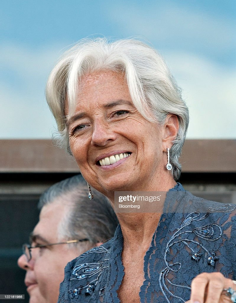 <a gi-track='captionPersonalityLinkClicked' href=/galleries/search?phrase=Christine+Lagarde&family=editorial&specificpeople=566337 ng-click='$event.stopPropagation()'>Christine Lagarde</a>, managing director of the International Monetary Fund (IMF), smiles as Augustin Carsten, governor of the central bank of Mexico, passes behind her in between sessions at the annual economic symposium sponsored by the Kansas City Federal Reserve Bank in Moran, Wyoming, U.S., on Friday, Aug. 26, 2011. U.S. Federal Reserve Chairman Ben S. Bernanke said at the symposium today that the central bank still has tools to stimulate the economy without providing details or signaling when or whether policy makers might deploy them. Photographer: Daniel Acker/Bloomberg via Getty Images