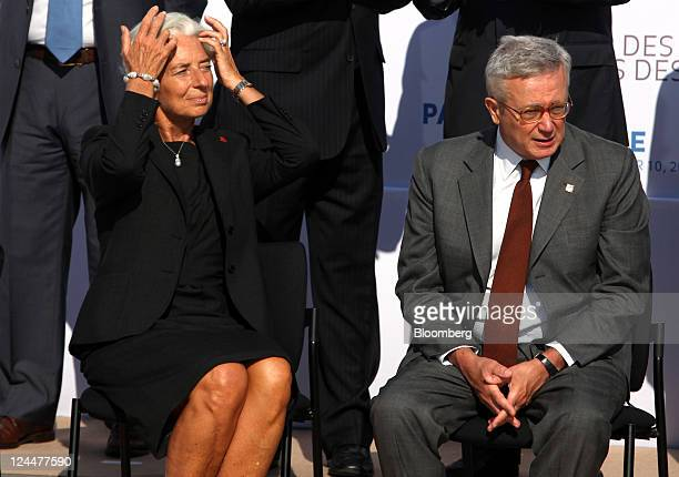 Christine Lagarde managing director of the International Monetary Fund left sits with Giulio Tremonti Italy's finance minister ahead of the family...