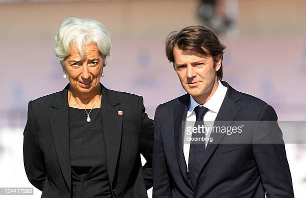 Christine Lagarde managing director of the International Monetary Fund left and Francois Baroin France's finance minister arrive for the family...