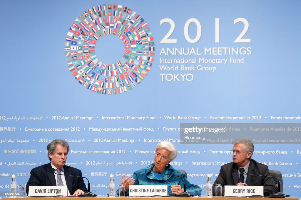 "Christine Lagarde, managing director of the International Monetary Fund (IMF), center, speaks as David Lipton, first deputy managing director of the International Monetary Fund (IMF), left, and Gerry Rice, director of external relations at the International Monetary Fund (IMF), listen during a news conference at the Annual Meetings of the International Monetary Fund (IMF) and the World Bank Group in Tokyo, Japan, on Thursday, Oct. 11, 2012. Lagarde says the fund will ""spare no effort"" to help Greece get back on track as the country's creditors negotiate in Athens measures to enable disbursement of a loan package. Photographer: Kiyoshi Ota/Bloomberg via Getty Images"
