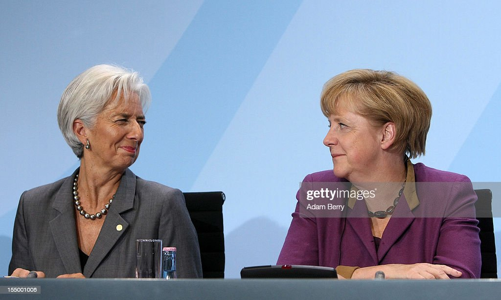 Christine Lagarde, managing director of the International Monetary Fund (IMF) (L), and German Chancellor Angela Merkel react at a news conference after a meeting on October 30, 2012 at the German federal chancellery in Berlin, Germany. Merkel met with the heads of five international financial and economic bodies to discuss the global economic outlook as well as the situation in Europe in particular, concentrating on policies to improve competitiveness, trade and development.