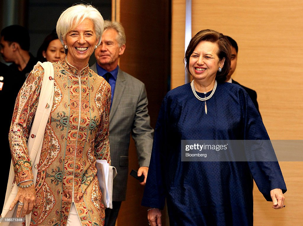 Christine Lagarde, managing director of the International Monetary Fund (IMF), left, walks with Zeti Akhtar Aziz, governor of Bank Negara Malaysia, right, as they arrive for a news conference in Kuala Lumpur, Malaysia, on Wednesday, Nov. 14, 2012. Lagarde today kicked off a three-country tour of Southeast Asia, which is thriving after emerging from turmoil more than a decade ago. Photographer: Goh Seng Chong/Bloomberg via Getty Images