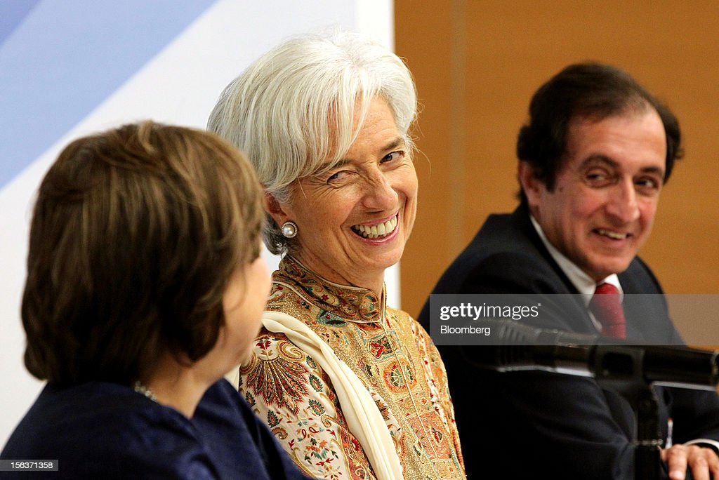 <a gi-track='captionPersonalityLinkClicked' href=/galleries/search?phrase=Christine+Lagarde&family=editorial&specificpeople=566337 ng-click='$event.stopPropagation()'>Christine Lagarde</a>, managing director of the International Monetary Fund (IMF), sits with <a gi-track='captionPersonalityLinkClicked' href=/galleries/search?phrase=Zeti+Akhtar+Aziz&family=editorial&specificpeople=767464 ng-click='$event.stopPropagation()'>Zeti Akhtar Aziz</a>, governor of Bank Negara Malaysia, left, and Anoop Singh, director for the Asia and Pacific Department of the International Monetary Fund (IMF), right, ahead of a news conference in Kuala Lumpur, Malaysia, on Wednesday, Nov. 14, 2012. Lagarde today kicked off a three-country tour of Southeast Asia, which is thriving after emerging from turmoil more than a decade ago. Photographer: Goh Seng Chong/Bloomberg via Getty Images