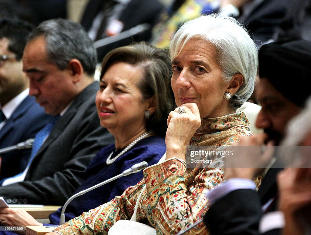 Christine Lagarde, managing director of the International Monetary Fund (IMF), center right, sits with Zeti Akhtar Aziz, governor of Bank Negara Malaysia, center left, during a conference in Kuala Lumpur, Malaysia, on Wednesday, Nov. 14, 2012. Lagarde today kicked off a three-country tour of Southeast Asia, which is thriving after emerging from turmoil more than a decade ago. Photographer: Goh Seng Chong/Bloomberg via Getty Images