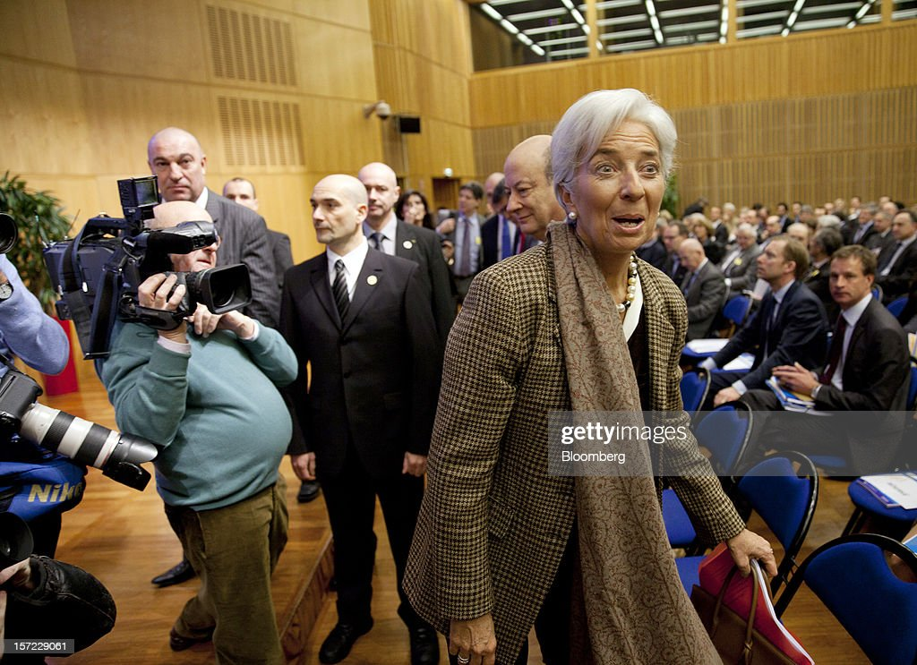 <a gi-track='captionPersonalityLinkClicked' href=/galleries/search?phrase=Christine+Lagarde&family=editorial&specificpeople=566337 ng-click='$event.stopPropagation()'>Christine Lagarde</a>, managing director of the International Monetary Fund (IMF), center, reacts as she arrives for a financial conference at the Ministry of Economy, Finance and Industry in Paris, France, on Friday, Nov. 30, 2012. The European Central Bank will do 'whatever is necessary to save euro' and is ready to intervene when needed, ECB President Mario Draghi said, while saying 'there will always be conditions' to intervention. Photographer: Balint Porneczi/Bloomberg via Getty Images