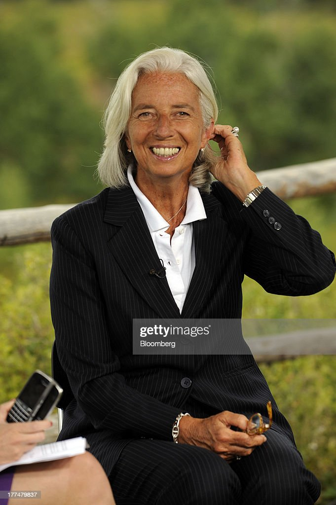 <a gi-track='captionPersonalityLinkClicked' href=/galleries/search?phrase=Christine+Lagarde&family=editorial&specificpeople=566337 ng-click='$event.stopPropagation()'>Christine Lagarde</a>, managing director of the International Monetary Fund (IMF), smiles during an interview at the Jackson Hole economic symposium, sponsored by the Kansas City Federal Reserve Bank at the Jackson Lake Lodge in Moran, Wyoming, U.S., on Friday, Aug. 23, 2013. The U.S. central banks bond buying is a less potent tool for stimulating growth than policy makers believe, two economists said in a paper released today at a Federal Reserve conference. Photographer: Price Chambers/Bloomberg via Getty Images