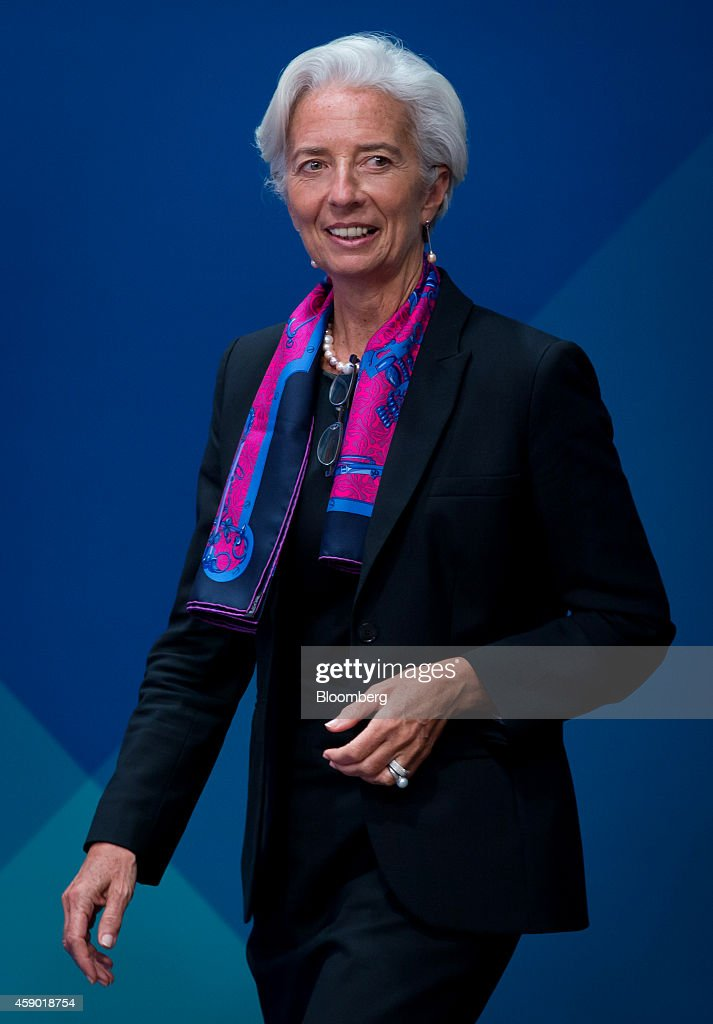 Christine Lagarde, managing director of the International Monetary Fund (IMF), arrives for a family photograph at the Group of 20 (G-20) summit in Brisbane, Australia, on Saturday, Nov. 15, 2014. Leaders of the world's 20 largest economies including U.S. President Barack Obama and Chinese President Xi Jinping gather in Brisbane this weekend to focus on economic issues. Photographer: Ian Waldie/Bloomberg via Getty Images