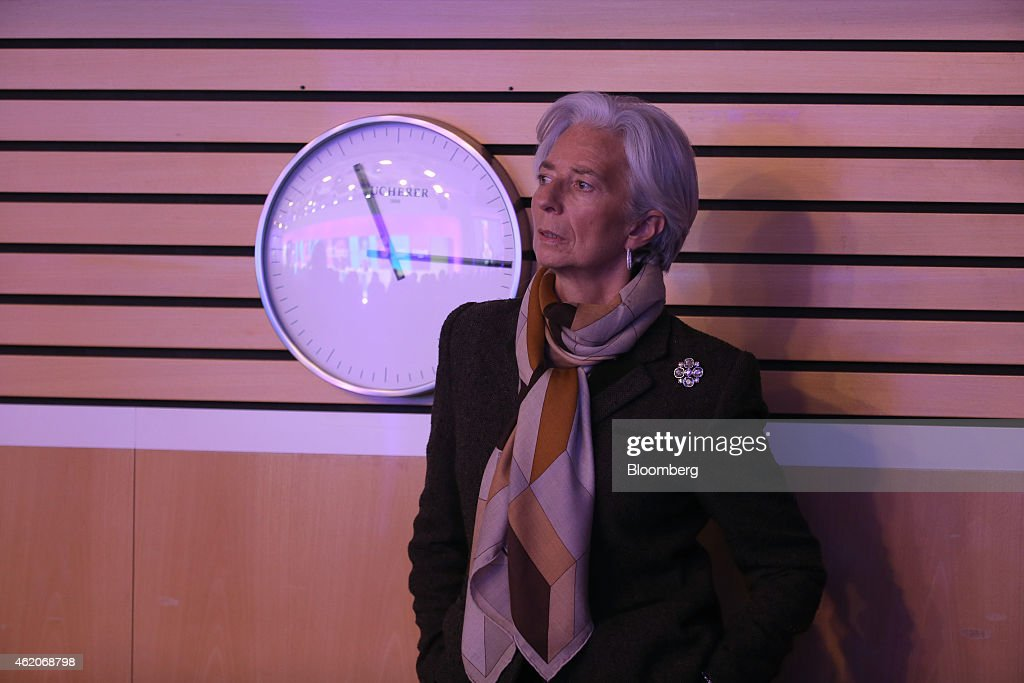Christine Lagarde managing director of the International Monetary Fund listens to a speaker during a session on the final day of the World Economic...